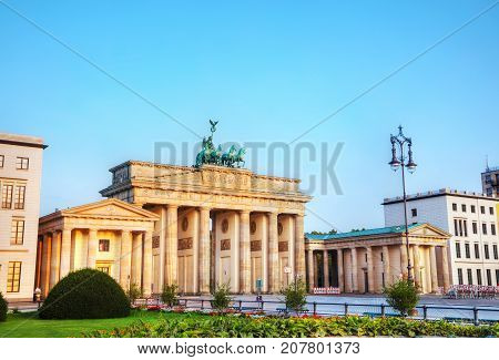 Brandenburg gate (Brandenburger Tor) in Berlin Germany at sunrise