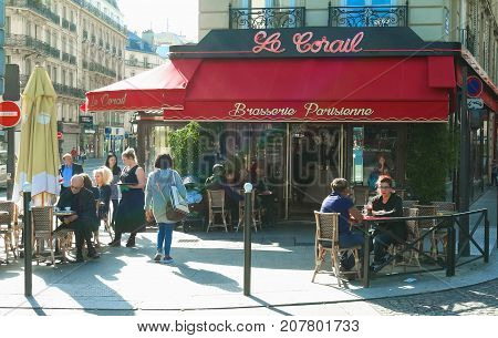 Paris, France - September 30, 2017: the traditional French brasserie Le Corail with unidentified people. It located in 9th district of Paris.