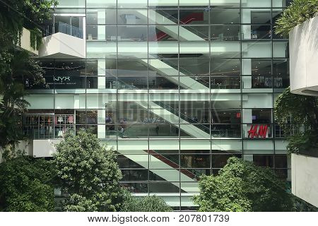 BANGKOKTHAILAND - AUGUST 1 2017 : People use to spend most of their free time on modern luxury shopping mall in Bangkok capital city.