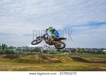 A Motorcycle Rider Participates In A Motocross Race. Jumps On The Trampoline.