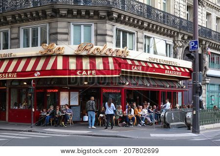 Paris, France - September 30, 2017: the traditional French brasserie La Rotonde with unidentified people. It located in 9th district of Paris.
