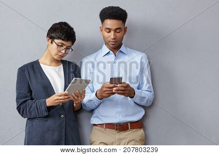Modern Students Being Always In Touch: Mixed Race Brunette Female Wears Formal Jacket Looks Attentiv
