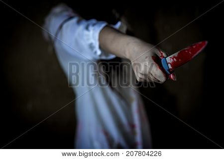Closeup Ghost woman or zombie hold knife for kill with blood violence in house of ruin nightmare horror of scary fear on hell is monster devil in halloween festival
