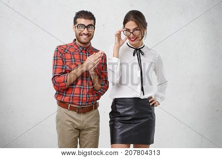 People, Facial Expressions And Happiness Concept. Good Looking Young Woman Wears Blouse And Leather