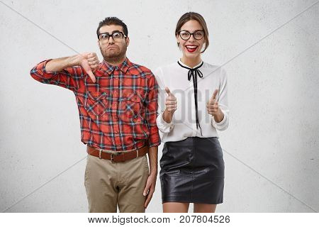 Like And Dislike Concept. Female And Male Companions Gesture With Thumbs, Express Different Emotions