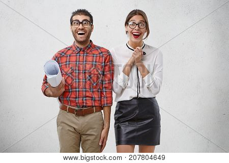 Excited Female And Male Being Glad To Finish Work, Exclaim Joyfully, Look With Bugged Eyes, Isolated