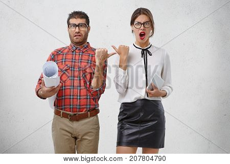 Emotional Female And Male Coworkers Point At Each Other With Dissatisfaction, Replace Guilt, Have Di