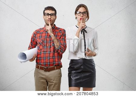 Conspiracy Concept. Two Female And Male Professors Show Silence Sign, Ask To Be Silent And Not To In