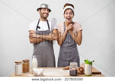 Astonished Overjoyed Female In Apron Looks With Bugged Eyes And Excitement Realizes That She Prepare