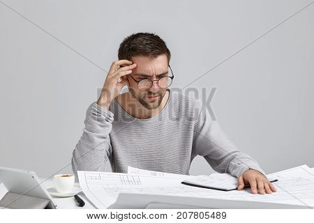 Clever Male Creative Worker Tries To Concentrate On Drawings, Doesn`t Understand Where Is His Mistak