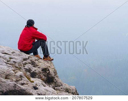 Man Tourist  Sit On Exposed Rock Summit.  View Point  Above Mist.  Sad Man Watching Over Autumnal Va
