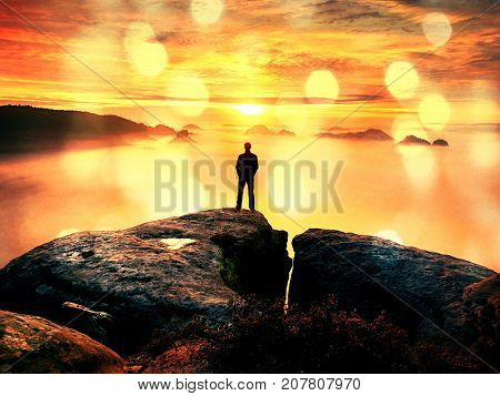 Hiker Watching To Autumn  Sun At Horizon . Beautiful Moment The Miracle Of Nature. Colorful Mist In