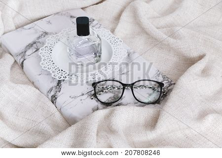 Perfumery On Wooden Stand And Glasses