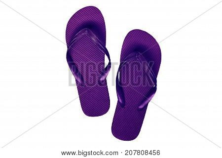Pink-purple rubber flip flops isolated on white background.