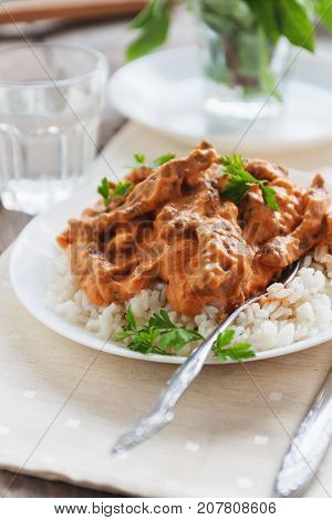 Dish Rice With Beef Stroganoff On A White Plate