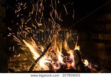 the fire in the furnace with sparks