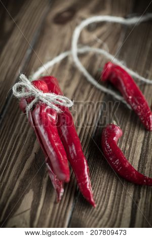 red hot chilli pepper on a wooden background