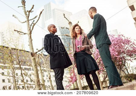 Business people talking in La Defense financial district, Paris, France