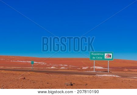 View on sign by the border to Chile and Bolivia in the Andes