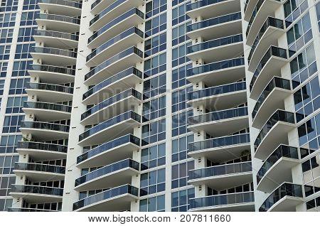 Window and terrace design on ultra-modern luxury condominium towers on Miami Beach,Florida
