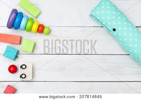 Wooden multicolor toys on a wooden background. Copy space