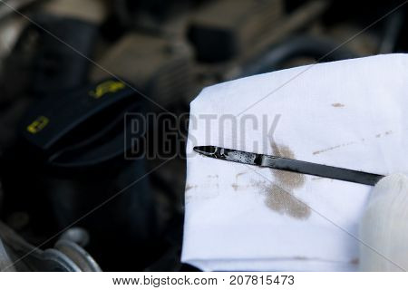 a stylus to check the engine oil is wiped with a white rag