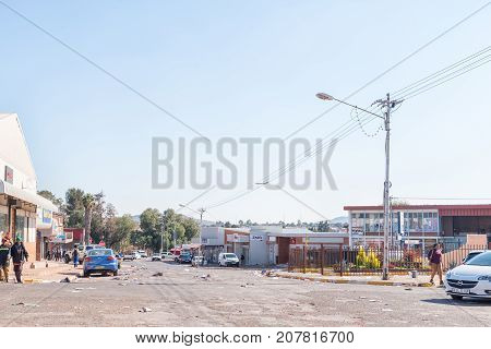 POSTMASBURG SOUTH AFRICA - JULY 7 2017: A street scene with trash strewn by protesters in Postmasburg a town in the Northern Cape Province of South Africa