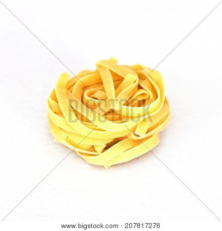 Uncooked Tagliatelle. Isolated