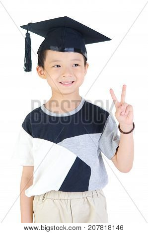 Happy and very glad asian school kid graduate with graduation cap isolated on white background