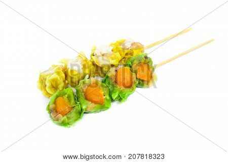 Close up yellow crab-filled & green salted egg pork-filled chinese steamed dumpling or dim sum isolated on white background - food chinese concept.