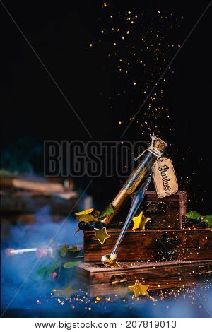 Stardust Test Tube With Wooden Boxes In A Magical Still Life With Golden Glitter And Stars. Wizard T