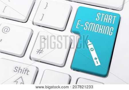 Close Up Of A Keyboard With The Blue Button Start E-smoking And A E-cigarette Icon