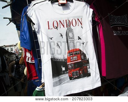 London, UK: July 26, 2016: Camden Lock Market Stall. T shirt on a market stall depicting Big Ben with an iconic red bus traveling past it.