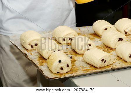 the preparation of viennoiserie pain au chocolat