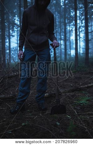 Eerie Man In Hoody With Spade In Misty Pine Forest.