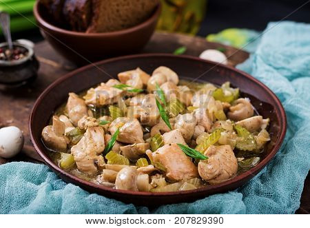 Delicate Chicken Fillet Pieces With Mushrooms And Celery Stewed In Light Beer