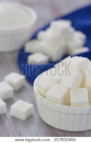 Diferent kind of white sugar refined in a bowl poster