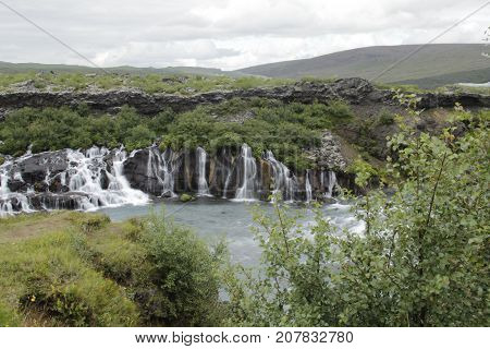 Barnafossar iceland , August 2017. Barnafoss is also known as Bjarnafoss, which was its previous name. Barnafoss is near Hraunfossar which burst out of Hallmundarhraun which is a great lava plain