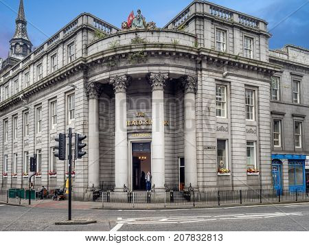 ABERDEEN, SCOTLAND - JULY 25: Facade of old buildings on Union Street on July 25, 2017 in Aberdeen Scotland.  Union Street is the historical centre of Aberdeen but it has been eclipsed by offices