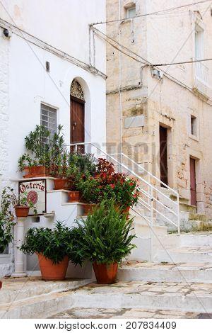 Lane in the white city, Ostuni, Apulia, Italy. Osteria means