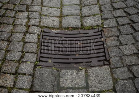 Drain cover in the middle of a road