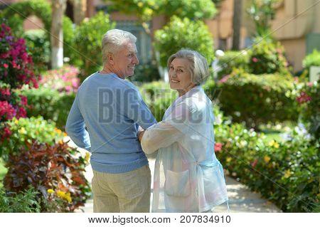 Portrait of a happy senior couple posing at resort