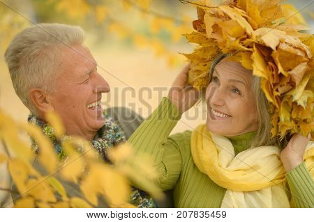 Outdoor portrait of elderly couple in autumnal forest