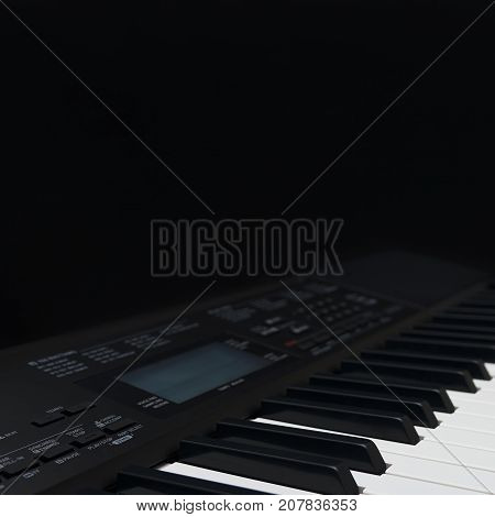 Synth on a black background close up