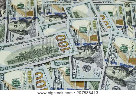 USA $ 100 money pictures, dollar pictures for financial sites, hundreds of dollars pictures, USA money pictures standing on a wooden floor,