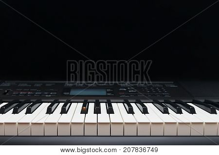 Keys of the electronic organ on a black background