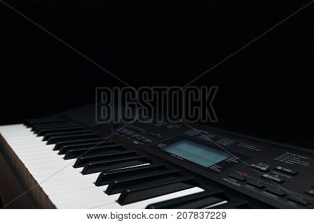 Keyboard of the electronic piano on a black background