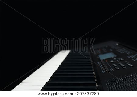 Keyboard of the digital synthesizer on a black background