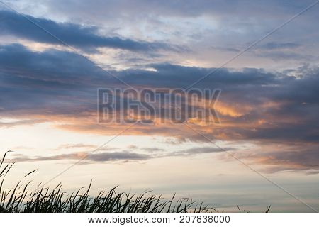 Beautiful nice blue and orange sky and could in sunset or sunrise