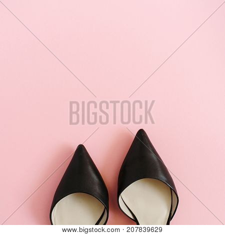 Fashion blog look. Black women high heel shoes on pink background. Flat lay top view trendy beauty female background.
